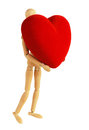 Wooden mannequin with red velvet heart Royalty Free Stock Photo