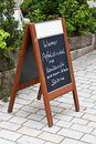 Wooden menu board on the street Royalty Free Stock Photo