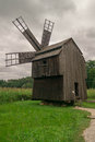 Wooden mill picture of an old windmill Royalty Free Stock Photo