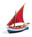Wooden model of a colorful boat with one sail Royalty Free Stock Photo