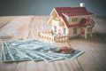 wooden model house with money on wood table with copy space read Royalty Free Stock Photo