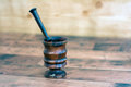 Wooden mortar and pestle mortar and pestle on a background Royalty Free Stock Photography