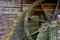 Wooden moss covered water wheel on an old grist mill Royalty Free Stock Photo