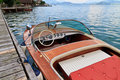Wooden motor boat on alpine lake Royalty Free Stock Photos