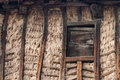 Wooden and mud wall and window a traditional way of building of houses in the north of spain with wood Stock Photo