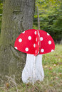 Wooden mushroom in forest Royalty Free Stock Photo