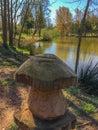 The wooden mushroom on the lake shore Royalty Free Stock Photo