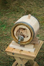 Wooden oak barrel wine, beer with metal crane. Sold at the fair. Royalty Free Stock Photo