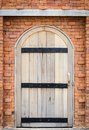 Wooden old door in brick wall background Royalty Free Stock Images