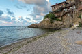 Wooden Old house and small beach in Sozopol Town, Bulgaria Royalty Free Stock Photo