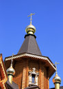 Wooden orthodox church fragment of a with carved windows Stock Photography