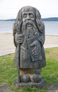 Wooden pagan idol great handwork is the stylized in russia karelia onego lake Royalty Free Stock Images