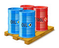 Wooden pallet and metal barrels with oil and petrol gasoline are on white background Stock Photos