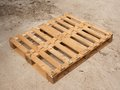 Wooden pallet on worn out concrete ground. Empty pallet Royalty Free Stock Photo