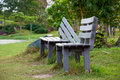 Wooden park bench at a park Royalty Free Stock Photo