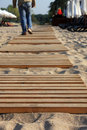 Wooden path on the beach. Royalty Free Stock Photos