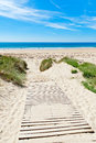 Wooden path over Dunes at a beach Stock Photography