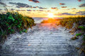 Wooden path at sunset over dunes a beach Royalty Free Stock Photography
