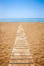 Wooden path to the sandy beach greece Royalty Free Stock Photography