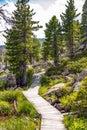 Wooden pathway around lake windebensee in carinthia nockalmstrasse austria Stock Photography