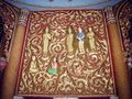 Wooden patterned icon with statues painted in gold in Thailand