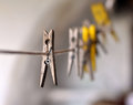 Wooden pegs on a rope and a blurry background Royalty Free Stock Photo