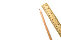 Wooden pencil an ruler on white isolated background Royalty Free Stock Photo
