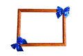 Wooden photo frame and blue bows Royalty Free Stock Photo