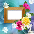 Wooden photo frame with roses Stock Image