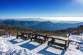 Wooden picnic tables with benches in winter,Deogyusan Mountains,  Korea. Royalty Free Stock Photo