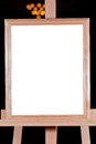 Wooden picture frame on easel Royalty Free Stock Photo