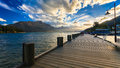 Wooden pier with beautiful lake Wakatipu Stock Photos