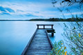 Wooden pier on big lake with long exposure Royalty Free Stock Photo