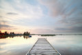 Wooden pier on big lake at sunset Royalty Free Stock Photo