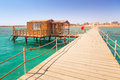 Wooden pier with change room house on red sea in egypt Royalty Free Stock Images