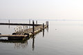 Wooden pier in a foggy morning Royalty Free Stock Photography