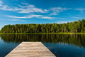 Wooden pier on lake scene Stock Photography
