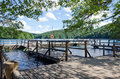 Wooden pier on lake a sunny day plitvice croatia Royalty Free Stock Photo