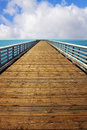 Wooden pier at Pacific coast Stock Images