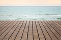 Wooden pier perspective with blue sea and pink sky on a background photo selective focus and shallow dof Stock Images