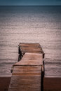 Wooden pier small leading into the sea in paignton torbay devon uk Royalty Free Stock Images
