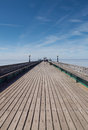 Wooden pier walkway clevedon traditional planked of in north somerset england on a blue sky summer day a popular tourist resort in Royalty Free Stock Image