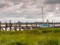 Wooden piers skipool creek thornton cleveleys lancashire uk august th at low tide at skipool creek lancashire uk Stock Photo