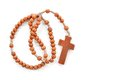 Wooden plain rosary on white background. Royalty Free Stock Image