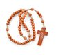 Wooden plain rosary on white background prayer beads use to count the repetitions of prayers of virgin mary Royalty Free Stock Photos