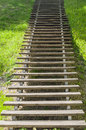 Wooden plank vanishing ladder in summer park stair outdoor Royalty Free Stock Photography