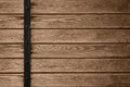 Wooden planks background with black metal bar Royalty Free Stock Photo