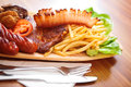 Wooden plate full of tasty food Stock Photo