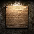 Wooden plate on wall Royalty Free Stock Photography