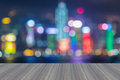 Wooden platform with abstract blurred bokeh Hong Kong city lights skylin Royalty Free Stock Photo
